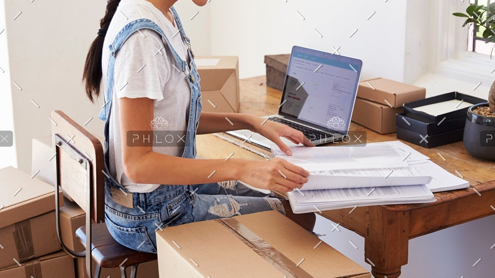 woman-running-business-from-home-working-on-PCZKTN9